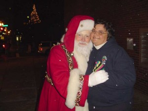 Santa and Sue Pye posing for a picture.
