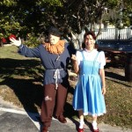 Dorothy and the Scarecrow are off to share Halloween yummies with their vendors.
