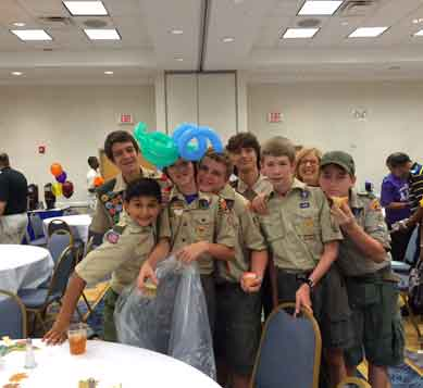 The young men of BSA Troops 573 and 578 helped serve food, assist seniors to their seats and hand out gifts.