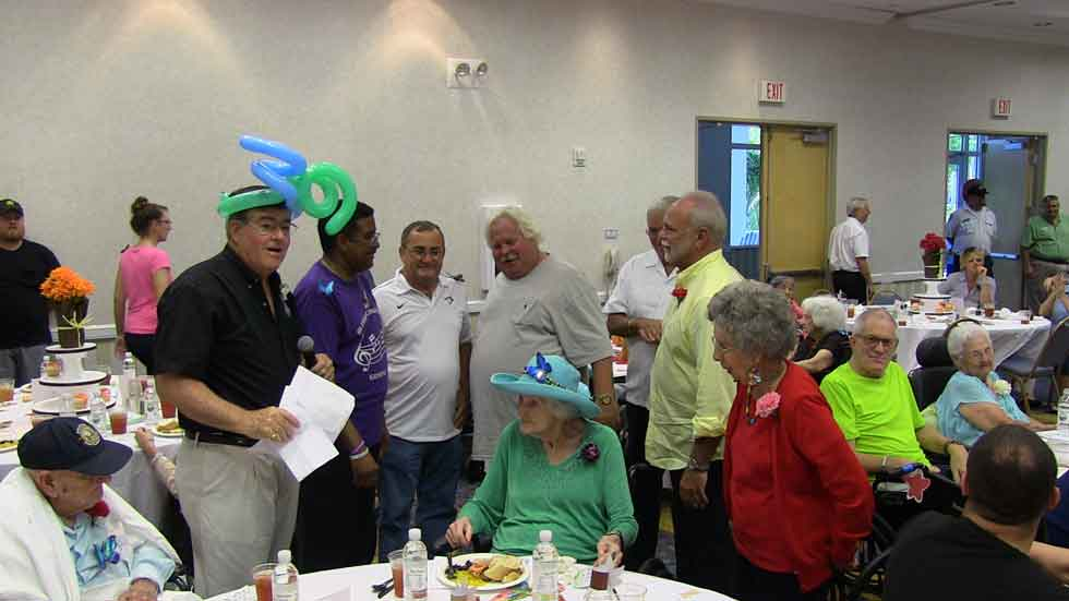 CEO Chris Belland, with Key West City Commissioners Clayton Lopez, Billy Wardlown, Mark Rossi, Key West Mayor Craig Cates and City Commissioner Tony Yaniz sing Happy Birthday to the seniors.