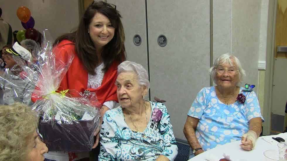Red Shawl Lady Dawn Albury presented Edith Rodas, the oldest woman at the event at age 99 young!